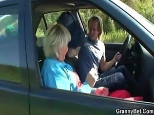 Granny is picked up from the road and fucked in the car