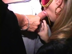 Masked MILFs suck and fuck at costume orgy