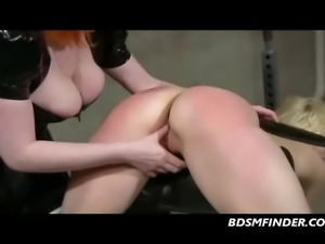 Latex redhead whips spanks paddles and electro stimulates her submissive...
