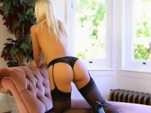 extremely hot luxury blond on the couch