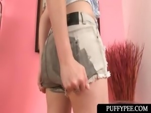 Lusty teenage hottie pissing in her tiny shorts