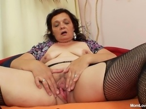 mature brunette masturbates in the bedroom
