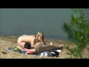Peeper catches a hot blonde blowing and riding on the beach free