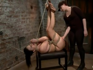 tied brunette receives a punishment that makes her ass red