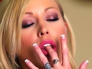 Alluring blonde Brea Bennett is fingering her lusty twat vigorously at the...