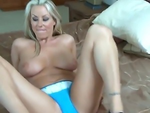 Naughty blonde named Carolyn Reese takes off her sexy lingerie and shows her...
