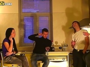 Sexy young brunette Emmy and her neighborhood guys at the kitchen