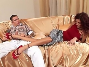 Arousing curly redhead slut Leanna Sweet with long legs plays with young dude...