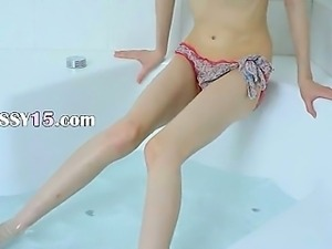 Skinny chick opening vagina in the bath