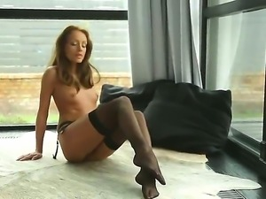 Arousing Sophie Lynx enjoys feeling her warm cunt getting wet while masturbating