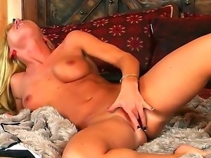 Beautiful and sexy blonde Niki Young rubs her pussy and masturbates with her...