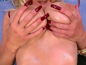 The attractive blonde pornstar Holly with a big tits demonstrates her pussy...