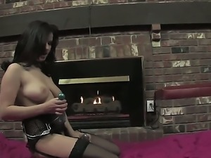 Busty brunette Julie is horny and loves masturbating her shaved cunt with a...