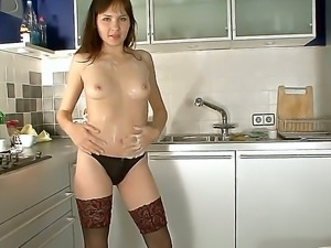 Nasty bitch named Jasha plays with her pussy and masturbates in the kitchen