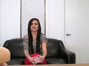 The prepossessing brunette whore with a tattooed hand and natural tits...