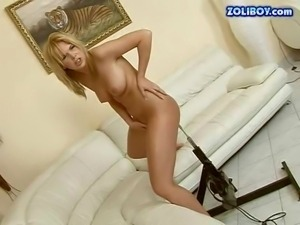 Attractive young tanned blonde amateur with nice natural hooters and