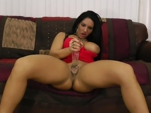 big breasted beauty plays with dildo