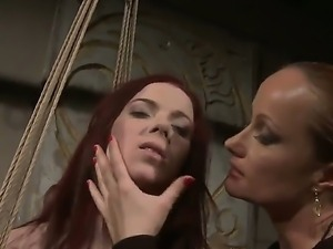 Redhead babe Niki Fox gets tied an dominated by a wicked mistress Katy Parker