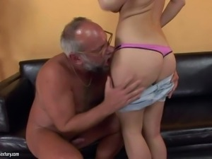 Cute young brunette with big fake hooters and sexy ponytail takes off hot...
