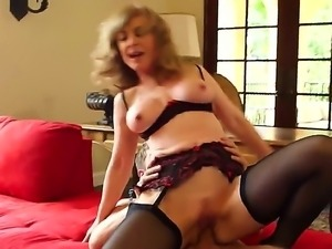 Mature blonde milf Nina Hartley gets seduced with a hunky young dude into...