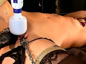 Black haired young Madison Parker gets tortured with Hitach vibrator by...