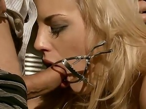 Blonde slutty bitch Laraan gets tied and given a huge cock to swallow as she...