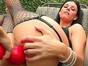 Hot lesbian brunette inserts a huge dildo in her pussy and another in her ass...