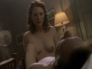 Julianne Moore nude giving us some great looks at her breasts during this...