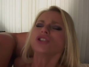 Blond slut is happy to get impaled on two boners