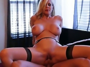 Horny blondy Julia Ann wears black stockings while taking a kinky ride on...