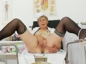Uniformed cougar gaping her own pussy
