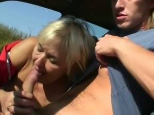 Slutty hitchhiker fucked by a young dude in a car