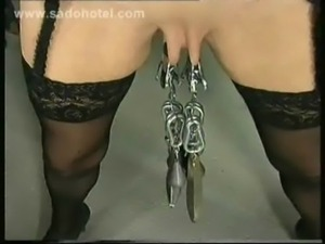 German slave gets pulled on nipples and large metal clamps with weight on her...