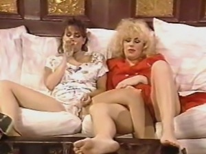 Busty brunette Christy Canyon teams with a blonde babe for steamy lesbian...