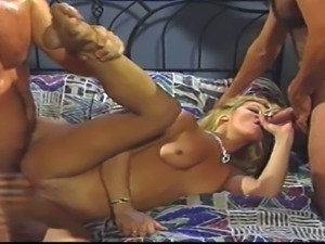 One of a kind porn queen Jill Kelly sucks two handsome studs and gets her...