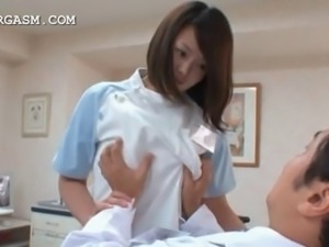 Curvy japanese nurse getting her big tits squeezed by the doctor