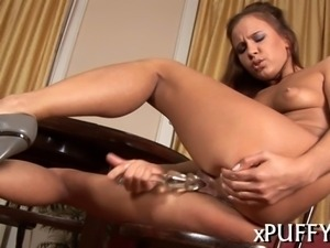 Beauty is tormenting her pussy lips with hard clippers