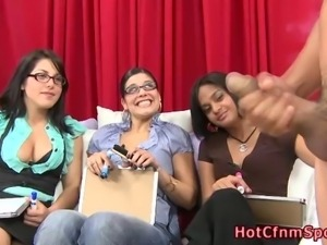Clothed babes watch guy jerking
