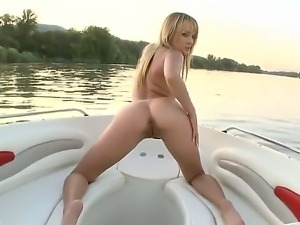 Pretty Blue Angel is fisting her tight shaved beaver while taking a boat ride...