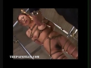 Suspended japanese slavegirl in asian bdsm and sexual domination of oriental...