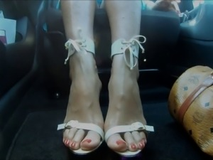 sexy feet & high heels in car