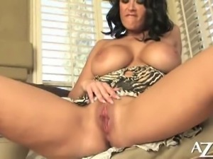 Busty brunette carmella bing plays with her pussy