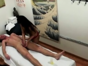 Busty handjob asian masseuse sucks dude