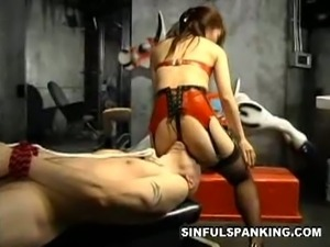 Asian domme tortures her slave and provokes