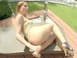 Long legged breathtaker Leyla Black in short dress and high heels plays with...