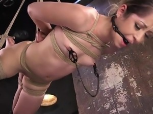 Goldie gets gagged, hogtied, and put up in the air to swing. Her executor...