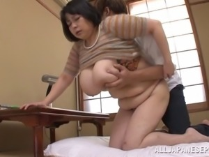 Mature Japanese cougar having her monster tits fondled while being fucked...