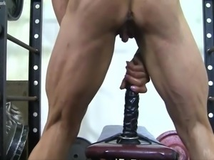 Muscle Babe Fucks a Dildo in the Gym