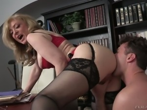 Sexy boss Nina Hartley makes her new employee worship her ass