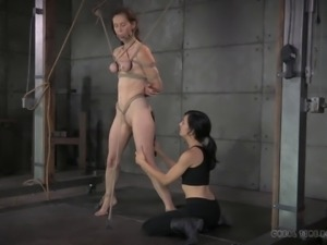 Skinny milf having her pussy pegged in BDSM torture